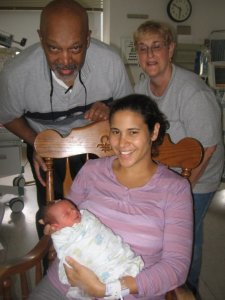 My parents and I with my second son in the NICU.